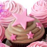 Magdalena del chocolate con las estrellas rosadas Imagen de archivo libre de regalías
