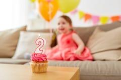 Magdalena del cumpleaños para el bebé de dos años Imágenes de archivo libres de regalías
