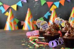 Magdalenas del chocolate para el cumpleaños imagen de archivo libre de regalías