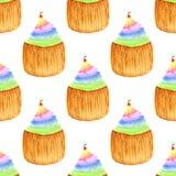 Magdalenas dulces con la cereza Modelo inconsútil del vector Pintura dibujada mano de la acuarela del arco iris Foto de archivo libre de regalías