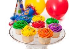 Magdalenas, globos y sombreros del partido Imagen de archivo libre de regalías