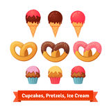 Magdalenas, pretzeles y helado Imagen de archivo