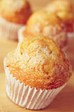 Magdalenas, typical spanish plain muffins. Closeup of some magdalenas, typical spanish plain muffins, on a wooden table Royalty Free Stock Photography