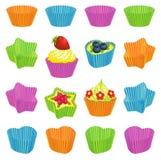 Magdalenas y tazas coloridas de la hornada Fotografía de archivo