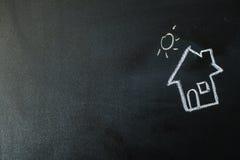 Mage eines Hauses mit Kreide Stockfotografie