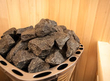 Mage of granite rock in sauna oven Stock Photos
