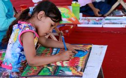 Paint Coloring Book. Magelang, Indonesia - April 8, 2018: Child paint a coloring book with color pencils stock image