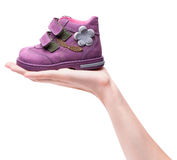 Magenta children`s boot on female hand Stock Image