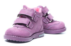 Magenta children`s boots Royalty Free Stock Photography