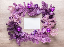 Magenta christmas wreath with blank card Royalty Free Stock Images