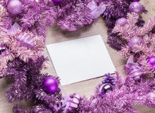 Magenta christmas wreath with blank card Royalty Free Stock Photography
