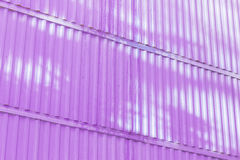 The magenta color of figure of corrugated texture. Concept: reliable, abstract, creative, art, fence. The magenta color of figure of corrugated texture stock photo