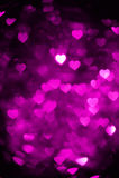Magenta color heart bokeh background photo. Abstract holiday, celebration backdrop. stock photo