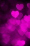 Magenta color heart bokeh background photo. Abstract holiday, celebration backdrop. stock photos