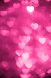 Magenta color heart bokeh background photo. Abstract holiday, celebration backdrop. Royalty Free Stock Photo