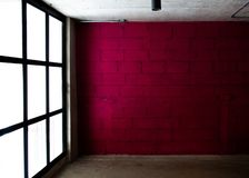 Magenta color wall background with frosted glass. Magenta color brick wall background with frosted glass royalty free stock photos