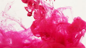 Magenta colored liquid slowly flowing