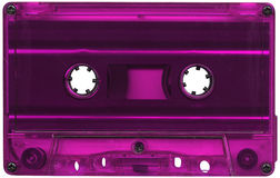 Magenta coloured cassette tape. Retro magenta plastic cassette tape Royalty Free Stock Photo
