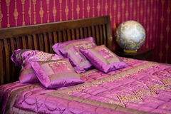 Magenta cushion on the bed Stock Photography