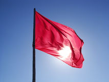 Magenta flag flying in a bright sky Royalty Free Stock Photos