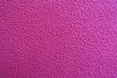 Magenta fleece fabric from above closeup. Magenta polar fleece fabric from above closeup Royalty Free Stock Photo