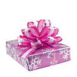 Magenta gift box with glossy ribbon. Magenta purple box tied with a ribbon-bow on white background stock image