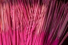 Magenta incense sticks Stock Images