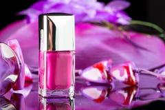 Magenta nail polish on  background of women's Royalty Free Stock Photography