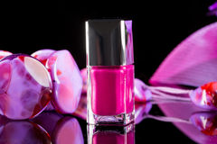 Magenta nail polish on  background of women's Stock Image