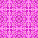 Magenta on pink ornamental scroll seamless repeat pattern background. Two colour ornamental scroll with dagger fleur de lis seamless repeat pattern background Royalty Free Stock Photo