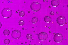 Magenta round water droplets background with pixel pattern. Round water droplets background with a pattern of pixels in a magenta colour Stock Photos