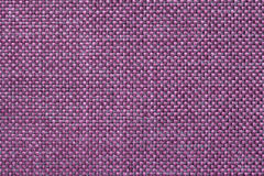 Magenta textile background with checkered pattern, closeup. Structure of the fabric macro. Dark violet background with checkered pattern, closeup. Structure of Royalty Free Stock Photo