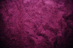 Magenta vintage background. Rough pink and magenta texture and background for designers. Close up view of abstract pink and magent