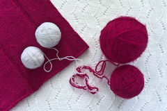 Magenta and white clews on knitwear Royalty Free Stock Photo
