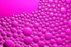 Magentafärgade bubblor Arkivfoto