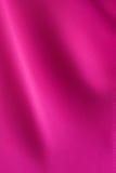magentafärgat tyg Arkivbild