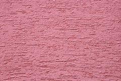 Magentarote Betonmauer. Stockfoto