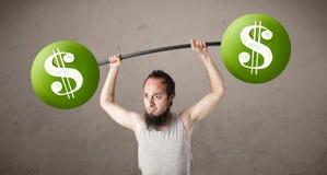 Mager grabb som lyfter gröna vikter för dollartecken Royaltyfri Bild