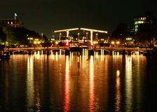 Magere bridge in Amsterdam at night Royalty Free Stock Image