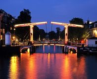 Magere Brug, Amsterdam, Holland. Skinny Bridge along the River Amstel at dusk (Magere Brug), Amsterdam, Holland, Netherlands, Europe stock images