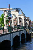 Magere Brug in Amsterdam, Netherlands. The Magere Brug is a bridge over the river Amstel in the city centre of Amsterdam. Amsterdam is the largest city and the stock photos