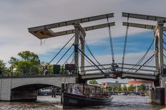The Magere Brug in Amsterdam. Amsterdam, the Netherlands. June 13, 2014. Impression of the famous magere brug -the skinny brigde- in central amsterdam, as seen royalty free stock images