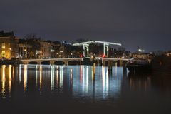Magere Brug in Amsterdam. At night stock image