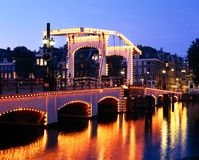 Magere Brug, Amsterdam. Magere Brug (Skinny Bridge) across the River Amstel at dusk, Amsterdam, Holland, Netherlands, Europe royalty free stock images