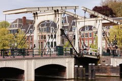 Magere Brug in Amsterdam. Skinny Bridge (Dutch: Magere Brug) over the Amstel river in Amsterdam, Netherlands, North Holland province stock image