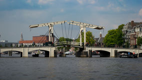 Magere Brug Bridge. View of the Magere Brug (Skinny Bridge), a bridge over the river Amstel in the city centre of Amsterdam. The present bridge was built in 1934 stock photo