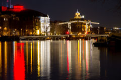 The Magere Brug (skinny bridge). Night shot of the Magere Brug in Amsterdam stock photos