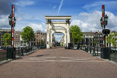 The Magere Brug, Skinny Bridge. Amsterda. AMSTERDAM - JULY 6: The The Magere Brug (Skinny Bridge) in Amsterdam on july 6. 2016 in Netherlands. Skinny Bridge is a stock images