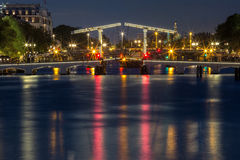 Magere Brug, Skinny bridge, Amsterdam, Netherlands. Magere Brug, Skinny bridge, with night lighting over the river Amstel in the city centre of Amsterdam stock photography
