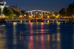 Magere Brug, Skinny bridge, Amsterdam, Netherlands. Magere Brug, Skinny bridge, with night lighting over the river Amstel in the city centre of Amsterdam royalty free stock image